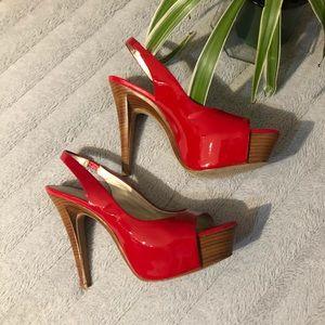 EUC red peep toed platform heels w/wood design